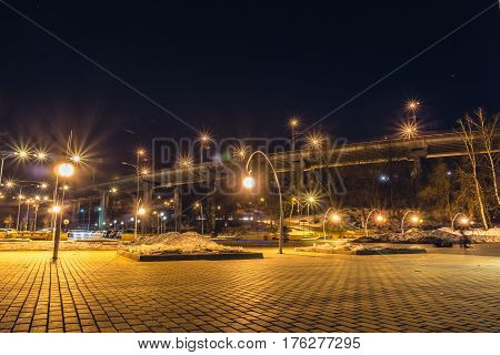Night view of the bridge and parking near the entrance to the park Dynamo, Voronezh city