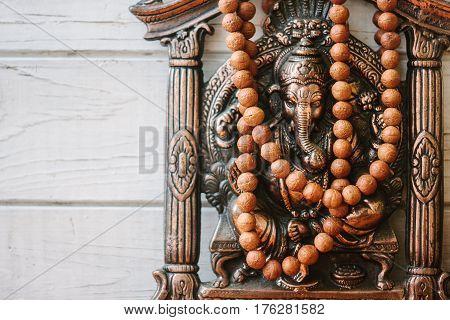 Hindu God - Ganesha With Rudraksha Rosary.