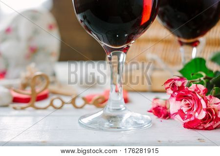 Flowers And Glasses Of Wine On Celebration Of Valentine's Day