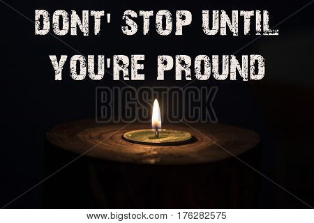 Dont' Stop Until You're Pround - White Candle With Dark Background - In A Wooden Candlestick