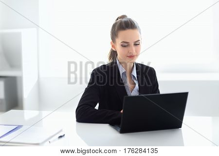 Portrait Of Beautiful Business Woman With Laptop In The Office