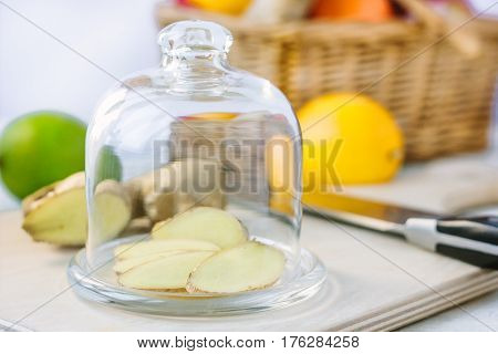 Slices Of Ginger Root Covered By Glass Cover.