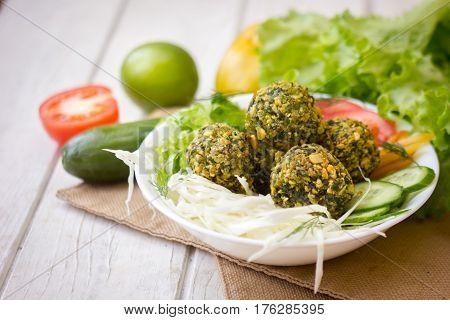 Delicious Falafel Salad. Salad Include Tomatoes, Cucmbers And Falafel.