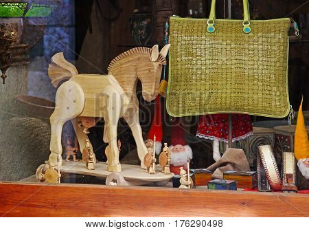 Besalu Spain - September 09 2014: Showcase with Trojan horse bag gnomes and strap in Besalu (Catalonia Spain)