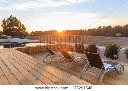 Chairs In Modern House With Wooden Deck