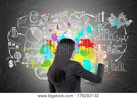Rear View Of Woman Drawing Colorful Business Icons