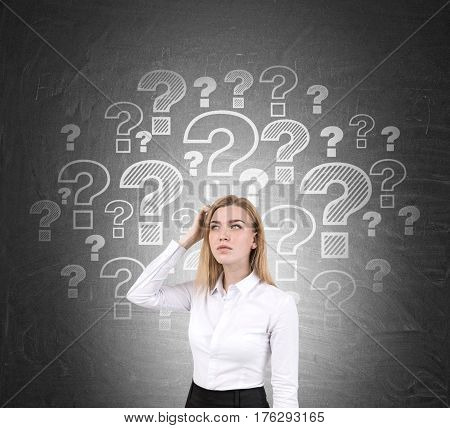 Confused Blond Woman And Question Marks