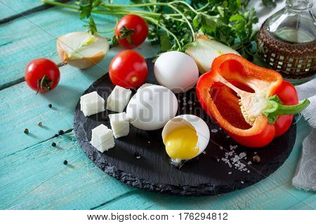 Ingredients For Cooking Egg Omelette Stuffed With Red Pepper And Cheese. The Concept Of Healthy Nutr
