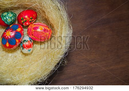 Easter eggs in the nest of sisal. Easter decorating idea for home. Closeup. natural materials