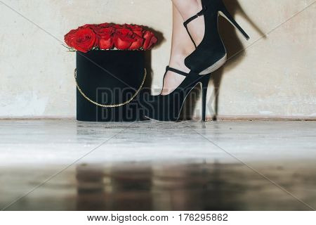 Sexy Female Legs With Beautiful Red Roses In Box