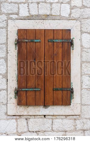 Old Wooden Retro Closed Window On The Stone Wall