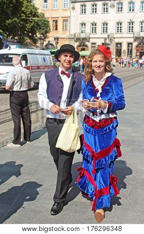 LVIV, UKRAINE - JULY 17, 2015: Couple in decorated costumes in the centre of Lviv