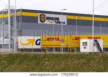 Dobroviz, Czech Republic - March 12: Dhl And Gls Shipping Containers In Front Of Amazon Logistics Bu