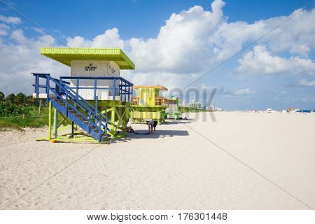 USA, FLORIDA, MIAMI. JANUARY 20, 2017. Lifeguard tower in a colorful Art Deco style, with blue sky and Atlantic Ocean in the background. World famous travel location. Miami Beach.