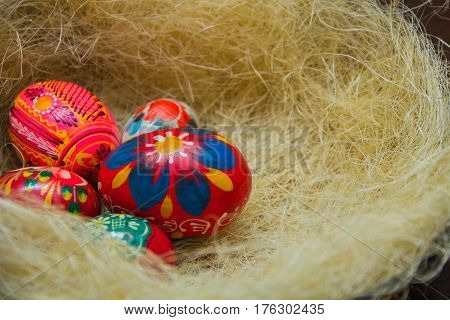 Easter eggs in the nest of sisal. Easter decorating idea. Closeup.