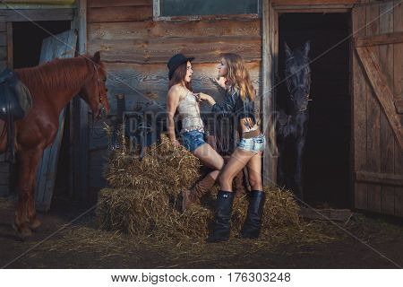 Women are on the ranch with horses. Women conflict with each other.