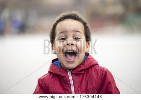 portrait of a beautiful multi racial boy with a huge smile