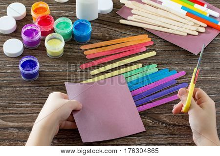 The Child Cut Paper Items. Present For St. Patrick's Day Clover On A Rainbow, A Craft Of Of Wooden S
