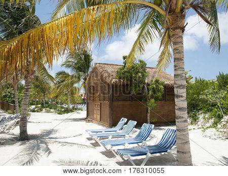 Still empty chairs in the morning on Grand Turk island beach (Turks and Caicos).