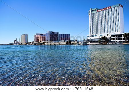 March 1, 2017 in Laughlin, NV:  Hotel Casinos beside the Colorado River taken in Laughlin, NV where people can walk on the Riverfront Boardwalk to different casinos and gamble while viewing the Colorado River