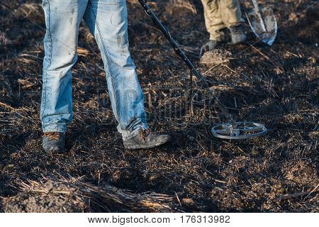 A person with a metal detector in a field search for coins hobbies. Recreation. Hobby. Ukraine.