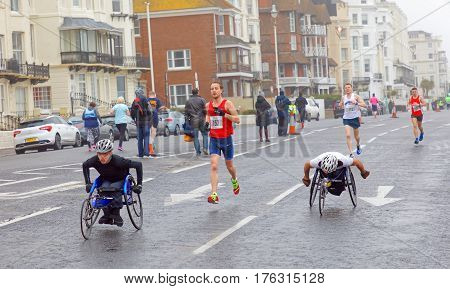 BRIGHTON GREAT BRITAIN - FEB 26 2017: Two men in sports wheelchair in the Vitality Brighton half marathon competition. February 26 2017 in Brighton Great Britain