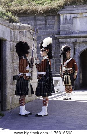 Halifax, Nova Scotia, September 23, 2015 -- Vertical of the changing of the guard by Members of the 78 Highland Guard at the Citadel in Halifax, Nova Scotia on a beautiful sunny day in September
