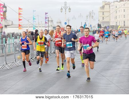 BRIGHTON GREAT BRITAIN - FEB 26 2017: Group of runners close to the finish line in the Vitality Brighton half marathon competition. February 26 2017 in Brighton Great Britain