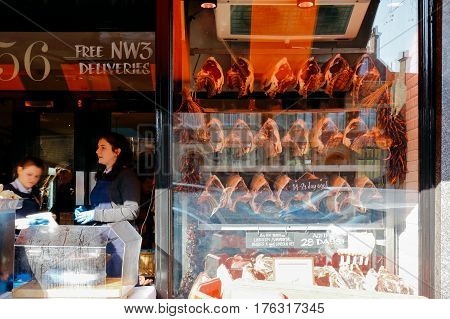 LONDON, UK - MARCH 14, 2016: Variety of fresh raw steaks in the shopfront of Hampstead Butchers.