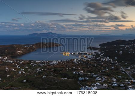 View of the harbor, Livadi village and Sifnos island in the distance from Chora, Serifos island in Greece.
