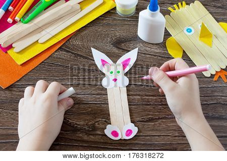The Child Draws Details Of Gift Items. Children's Easter Gift Toy Chicken And Easter Bunny. Hand-mad
