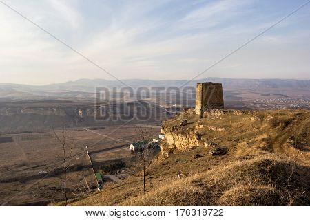 Old tower on a hillside to the gorge, a landscape, gorges of the North Caucasus