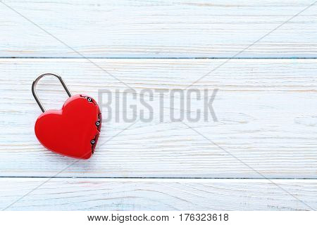 Heart Shaped Padlock On White Wooden Table