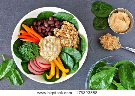 Nutritious Lunch Bowl With Quinoa, Hummus And Mixed Vegetables, Overhead Scene On A Slate Background