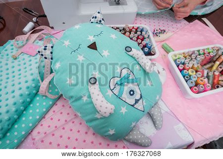 handmade toys on table with sewing machine