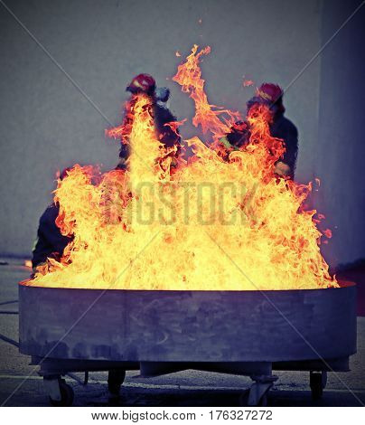 Brave Firefighters During The Test Of A Fire Extinguishing