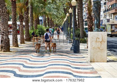 Alicante, Spain - June 30, 2016: The promenade Explanada of Spain in Alicante is paved with 6.5 million marble floor tiles creating a wavy form and is one of the most lovely promenades in Spain