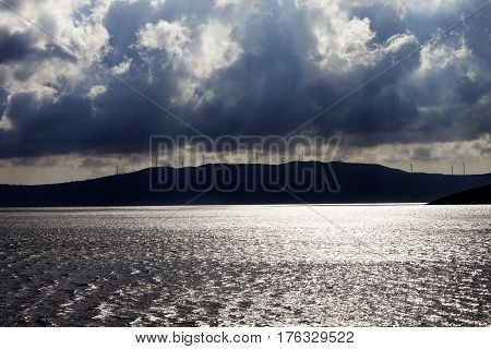 Sunlight Sea, Wind Farm On Mountains And Cloudy Sky Before Storm