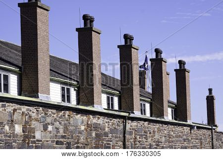 Halifax, Nova Scotia, September 23, 2015 -- Side view of the brick smokestacks on the side of the military barracks at Citadel Hill in Halifax Nova Scotia on a bright sunny day in September