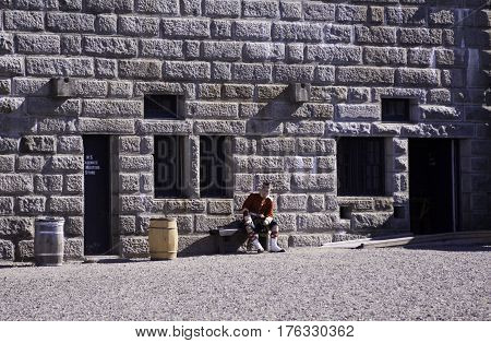Halifax, Nova Scotia, September 23, 2015 -- A single Highland guard takes a break at the Citadel in Halifax, Nova Scotia on a bright sunny day in September