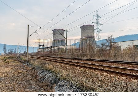 Cooling towers of thermal power plant near the railway