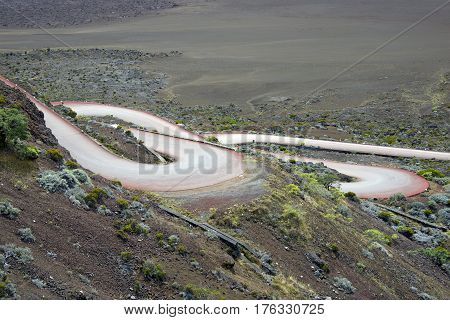 Road in volcanic landscape of Plaine des Sables Reunion Island National Park