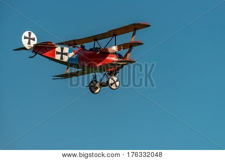 RHINEBECK NY - SEPTEMBER 25 2016: The Aerodrome Air Show Team perform a show with the World War I plane Fokker Dr-I (Reproduction) at Old Rhinebeck Aerodrome