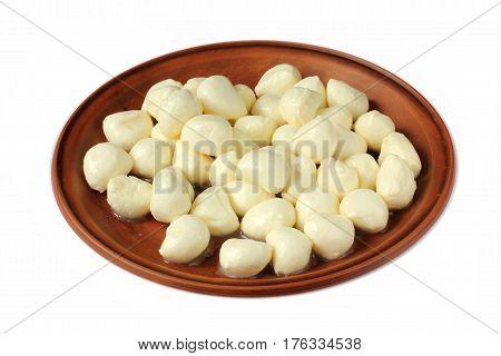 Mozzarella mini balls in a bowl isolated on white background