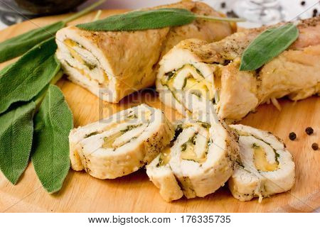 Stuffed roll of chicken breast with cheese and sage selective focus