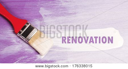 White paint brush stroke on violette half-painted wooden surface. Renovation concept