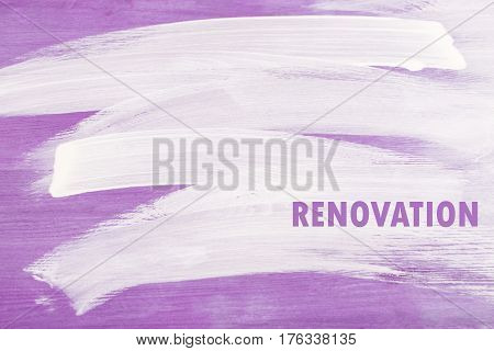 Half painted wooden surface. White strokes on violette background. . Renovation concept