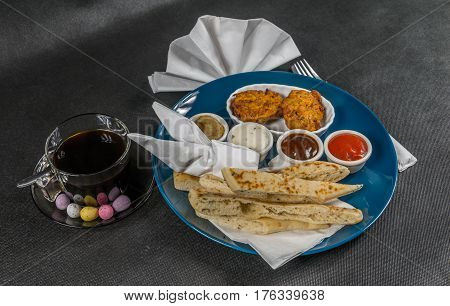 Oriental Indian Set,  Naan Bread And Onion Bhaji, Four Sauces, Blue Plate, Black Coffee
