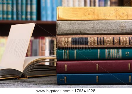 Old books in the Library on wooden background