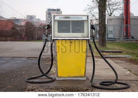 Rusted old and abandoned gas dispenser in a former petrol station shot in the suburb of Belgrade Serbia